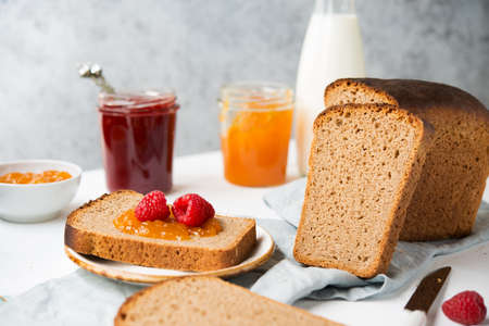 Fresh homemade bread with jam and milk, homemade simple food, selective focus