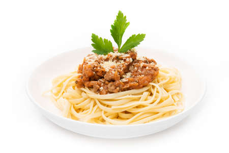 Plate of spaghetti bolognese in tomato sauce isolated on a white background