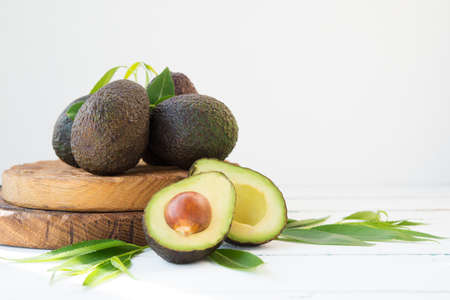 Haas avocado on a wooden board, natural products, selective focus, copy space Zdjęcie Seryjne