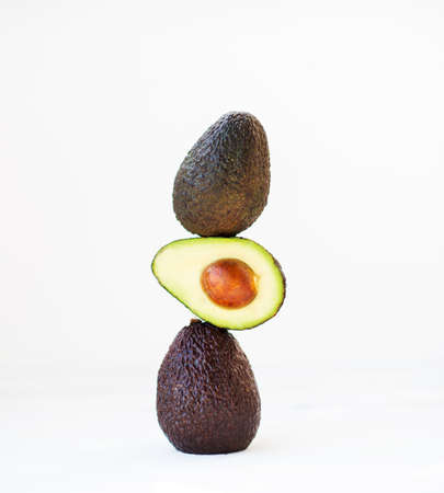 Haas avocado on a white background, selective focus, creative picture Zdjęcie Seryjne