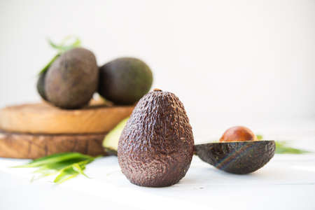 Haas avocado on a wooden board, natural products, selective focus Zdjęcie Seryjne