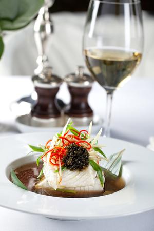 White fish fillet with white wine. Fine dine.
