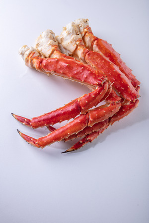 Large phalanx of crab legs Fresh boiled crab meat. Stock Photo