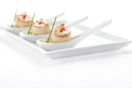 scallop and seafood salad appetizer in decorative spoon