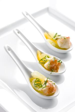 Tapas. Orange shrimp appetizer in decorative spoon.