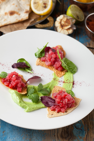 Delicious tartar with toasted bread salad. Healthy raw meat. Classic French cuisine. Archivio Fotografico