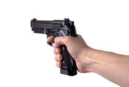 hand gun: gun in hand on a white background