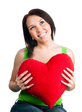 beautiful young brunette with red heart isolated on white background photo