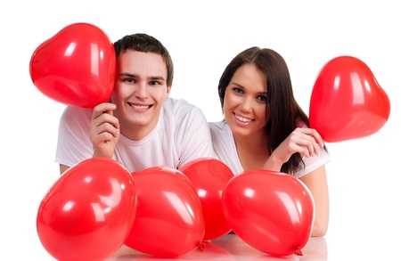 adult dating: Couple with a red heart on white background