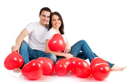 Couple with a red heart on white background Stock Photo - 8689789