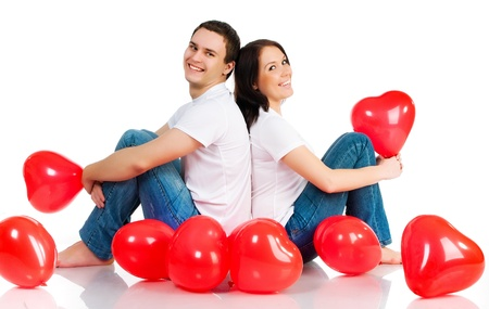 Couple with a red heart on white background photo