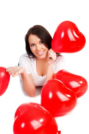 beautiful young brunette with red hearts isolated on white background photo