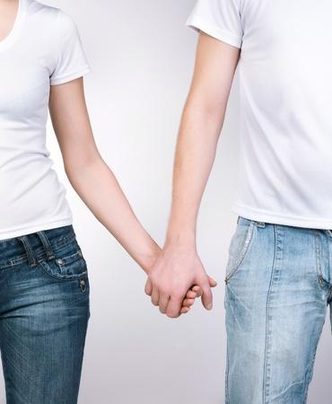 Boy und Girl holding hands