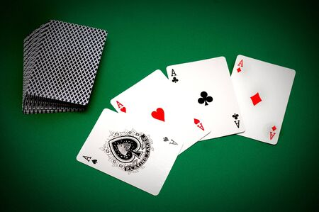 game of chance: Cards and poker chips on a green background