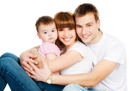 happy family with a baby on a white background photo