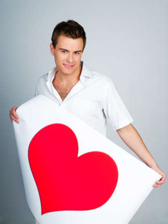 handsome young man holding a red heart Stock Photo - 8908961