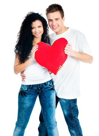 feelings of happiness: beautiful young couple holding a red heart Stock Photo
