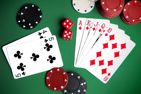 playing cards and chips on a green background Stock Photo - 8893403