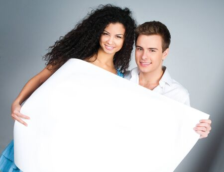 beautiful young couple holding a paper Stock Photo - 8918077