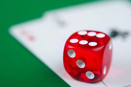 Close-up of  red dices on a green background photo
