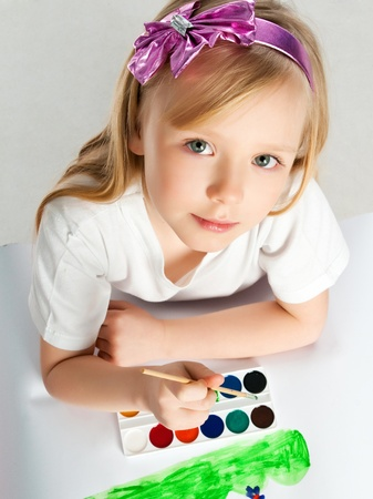 cute little girl with a brush and paints Stock Photo - 9023720