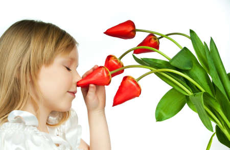 cute little girl with red flowers on white photo