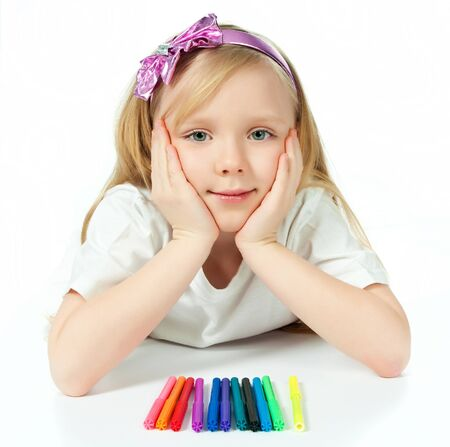 cute little girl with colored pencils photo