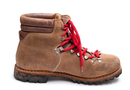 brown mountain boots isolated on a white background photo