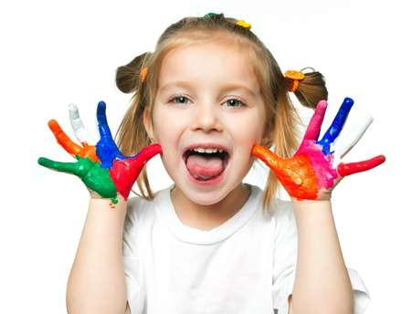 beautiful little girl with her ??hands in the paint Stock Photo - 9275126
