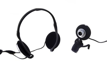 hands free device: web camera and headphones on a white background