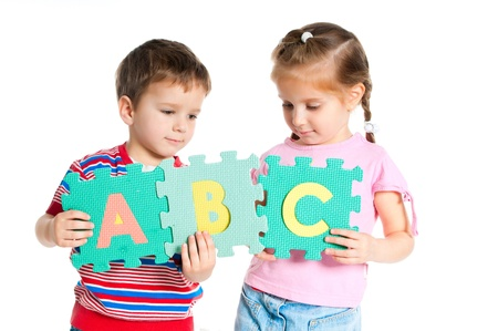 abc kids: boy and girl are holding colorful letters