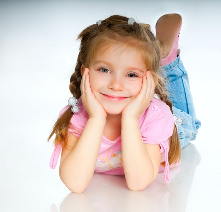 little girl smiling: beautiful little girl isolated on a white background