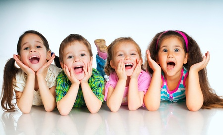 happy children: laughing small kids on a white background Stock Photo