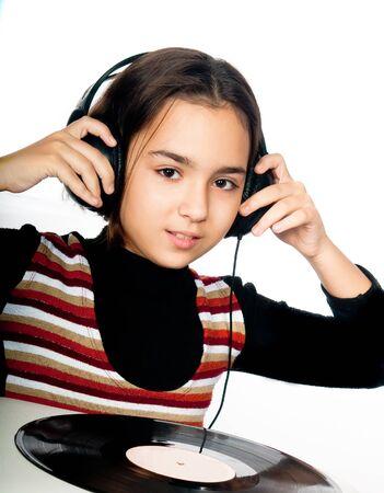 beautiful preschool child with headphones  photo