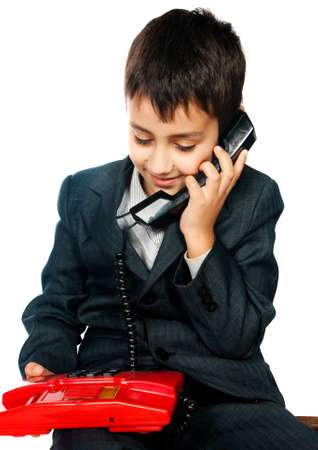 young boy talking on the phone isolated on white background photo
