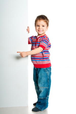 boy beside a white blank for text or image Stock Photo
