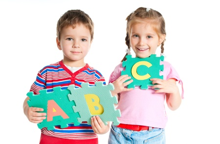 boy and girl are holding colorful letters Stock Photo - 9658515