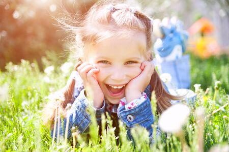 pretty eyes: cute little girl smiling in a park close-up