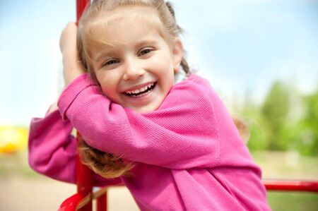 pretty little girl: cute little girl smiling in a park close-up