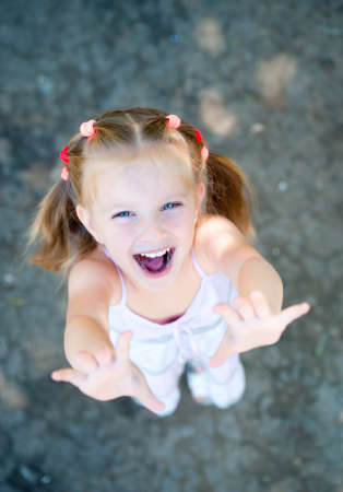 cute little girl smiling in a park close-up photo