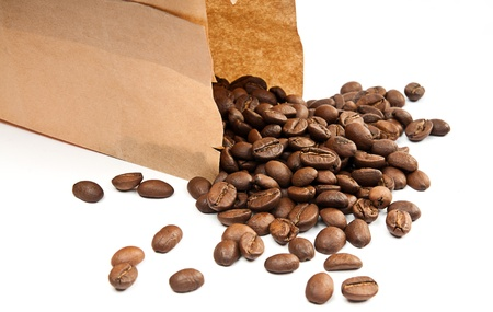 coffee poured from a brown package on the table photo