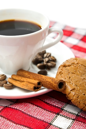 cookies, coffee and cinnamon on a red tablecloth photo