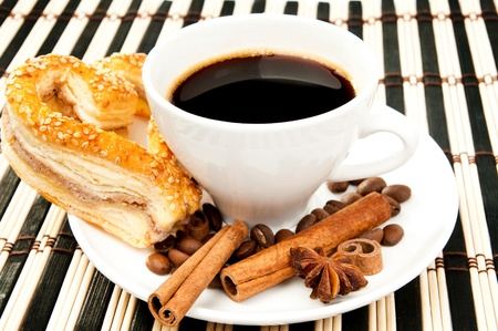 cookies, coffee and cinnamon on a striped tablecloth photo