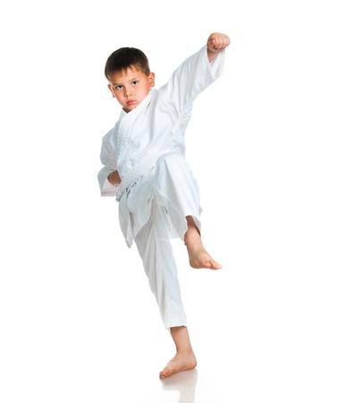 little boy in a kimono on a white background photo