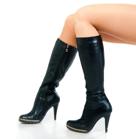 black leather boots isolated on white background photo