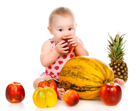 hungry children: small child with vegetables and fruits on white Stock Photo