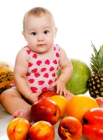 small child with vegetables and fruits on white photo