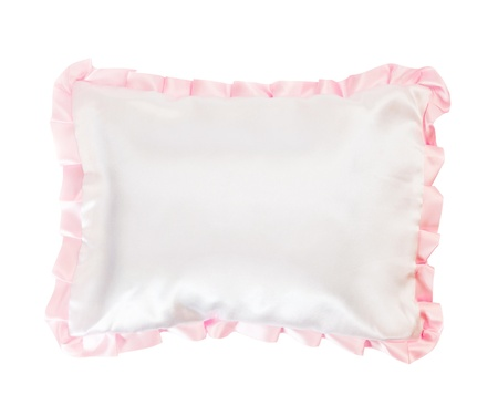white pillow with a pink frill on white photo