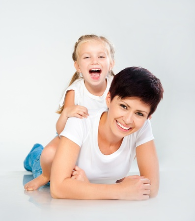 Mother and daughter laughing and looking at camera Stock Photo