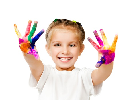 messy paint: beautiful little girl with her ??hands in the paint Stock Photo